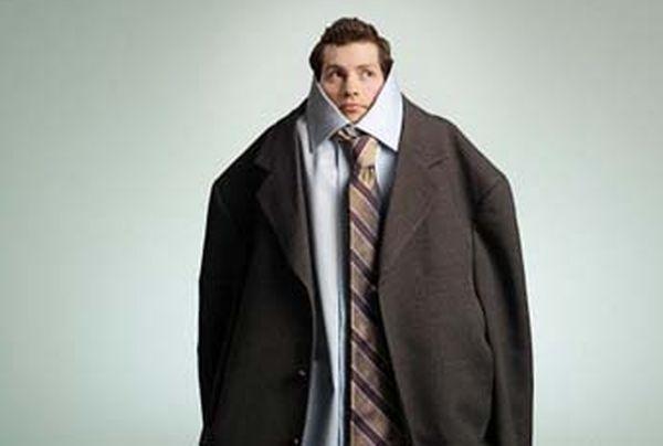Man wearing oversized suit
