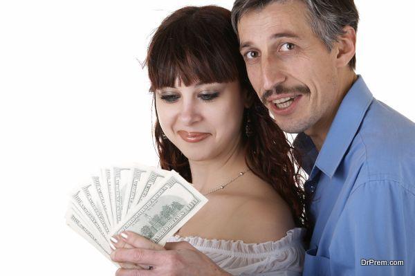Happy family with money