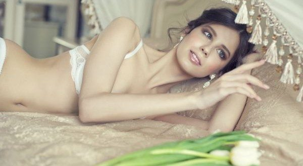 Beautiful bride in white lingerie
