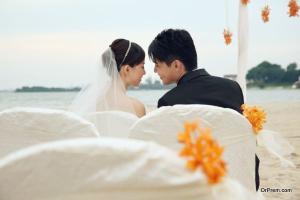 Ribbon-tied backdrop and chairs