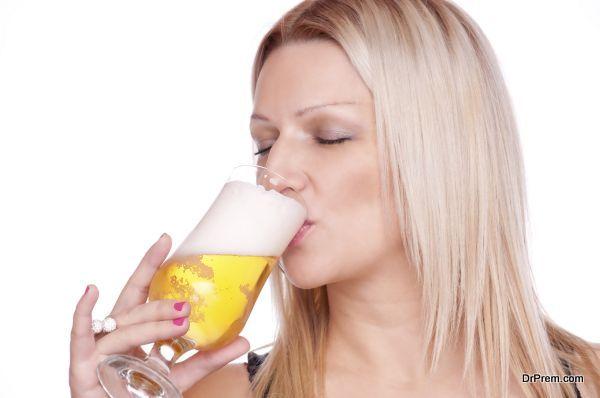 Blonde drinking beer
