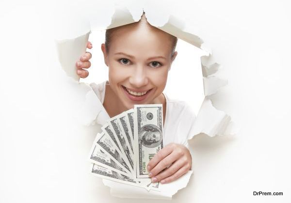 financial concept, woman with money peeking through hole in paper